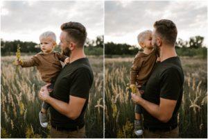 Tata trzyma chłopca na rękach - Sesja ciążowa na łące w plenerze Poznań